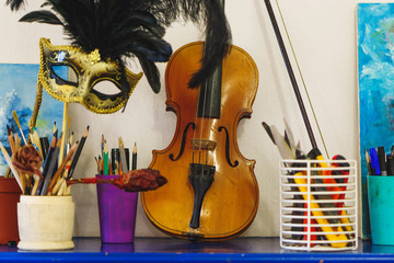 Violin near pencils cup