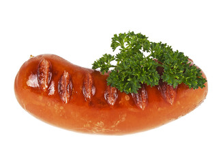 Tasty grilled sausage and twig of parsley on a white background