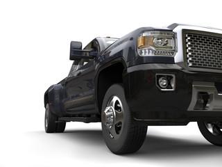Dark gray pickup truck - low angle headlight closeup shot