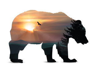 Silhouette of bear with nature background. Panorama of wild mountains. Pine trees. Sunset.