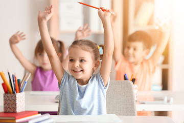 Cute girl at lesson in classroom Wall mural
