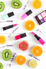 fruit design with cosmetic for make-up on white background top view pattern