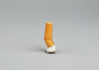 Cigarette butt on light background