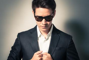 Portrait of handsome man in suit.
