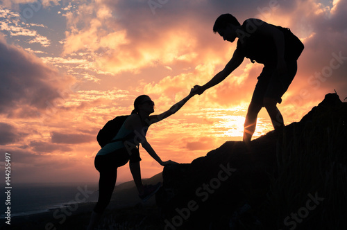 """Helping Each Other: """"Team Work. Man And Woman Helping Each Other Climb Up A"""