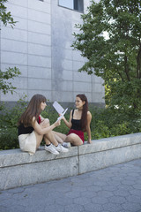 Two young women reading
