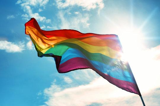 Gay flag on sky background