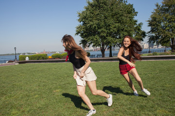 Two young women playing at a park