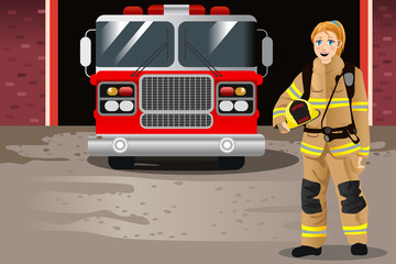 Female Firefighter in Front of Fire Station