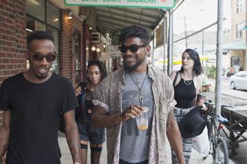 A group of friends walking down a street.