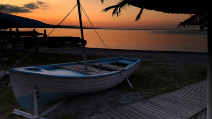 Old boat on the beach at beautiful sunset