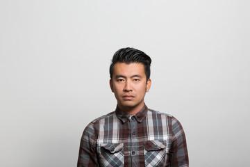 Studio portrait of a pensive young man