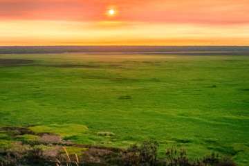 Sunset over the floodplains from Ubirr Rock - Kakadu national Park, NT, Australia.