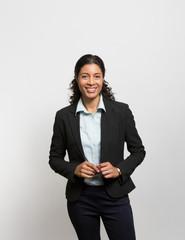 Studio portrait of a smiling businesswoman