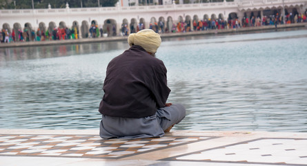 Old Sikh prays near the Golden temple