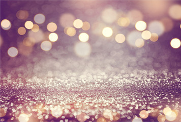 Pink or purple glitter and gold lights bokeh background. defocused Wall mural