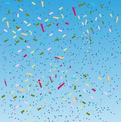 falling confetti on blue sky background