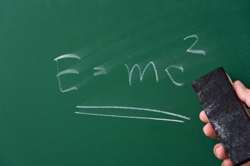 Theory of relativity formula written on chalkboard