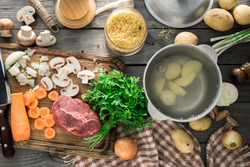 Raw ingredients for cooking soup on wooden table