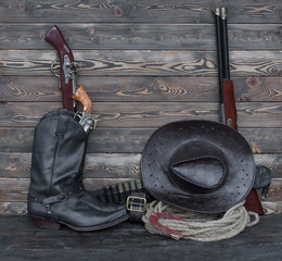Old rifle, cowboy boots, wild west, barn, ranch