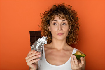 young curly woman with avocado and chocolate