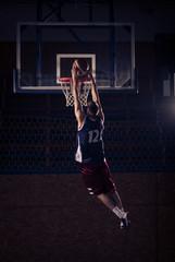 basketball player slam dunk, in air