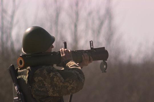 Military shooting from bazooka at warfield