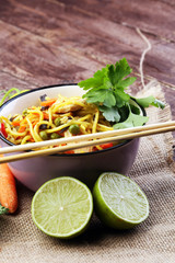 Traditional indonesian meal bami goreng with noodles, vegetables