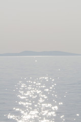 The reflection of sunlight dancing on the surface of the sea