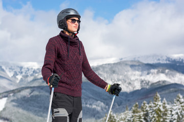 Skier in a glasses and a helmet in the mountains