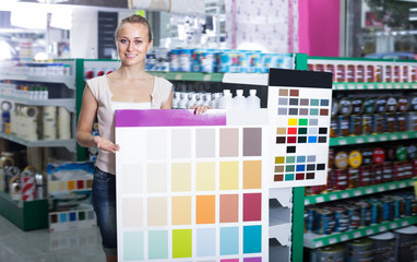 Adult woman picking color for paint