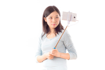 Asian Young Woman take the selfie