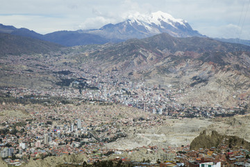 Aerial view of La Paz city in Bolivia and the Illimani mountain in the background