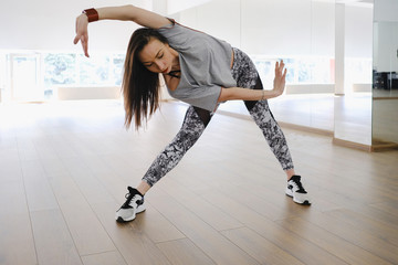 Young modern dancer dancing in the studio. Sport, dancing and urban culture concept