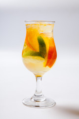 alcoholic cocktail with rum liqueur orange lime and tequila. White background