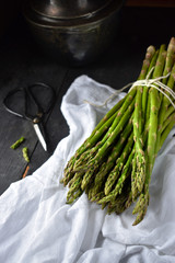 Fresh Asparagus bundle in rustic setting