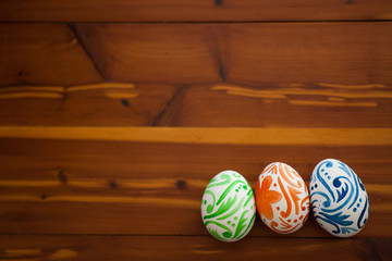 Easter eggs sitting on wooden table