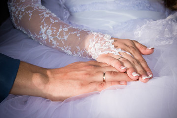 Bride holding hands in front of the dress