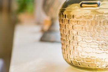 Decorative glass bottle on restaurant table