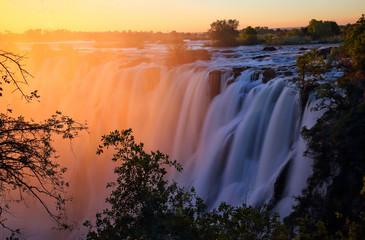 Fototapeten Wasserfalle Victoria Falls at sunset. Zambia