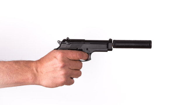 Hand with a pistol with a silencer