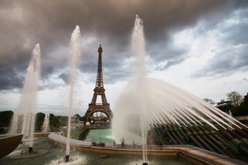 Fountains in Paris at the Trocadero square near the Palace of Chaillot. Travel through Europe. Attractions in France. The gray sky above the Eiffel Tower