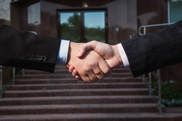 Business agreement. Handshake on background Bank. Shake hands with each other. Friendship partners.