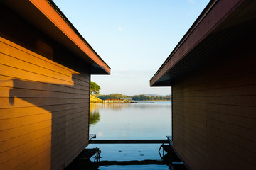 Orange wall of floating house and blue sky