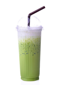 green tea cold matcha  in a glass isolated white background