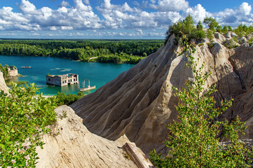 mountain, forest and turquoise lake in the village of Rummu. Abandoned quarry for extraction of limestone. Beautiful nature, attraction in Estonia. The summer season.