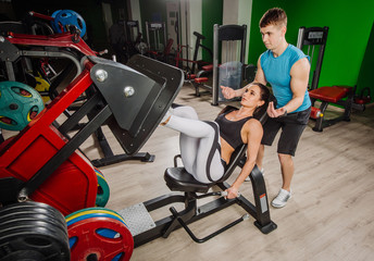 Exercise with trainer. Sporty lifestyle, bodybuilding, training concept