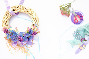 Handmade garland made of flowers and ribbons