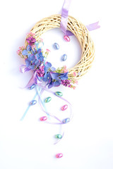 Beautiful pastel Easter Easter wreath with chocolate eggs