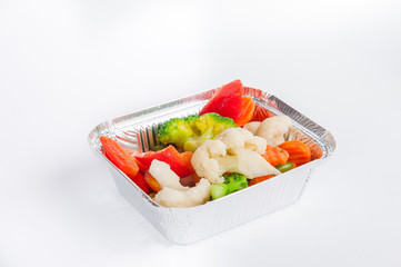 Healthy food, take away of natural organic meals in foil container. Fitness diet nutrition, Steamed vegetables closeup. Restaurant dishes delivery